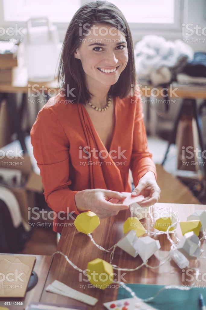 Craftsperson working in her workshop stock photo