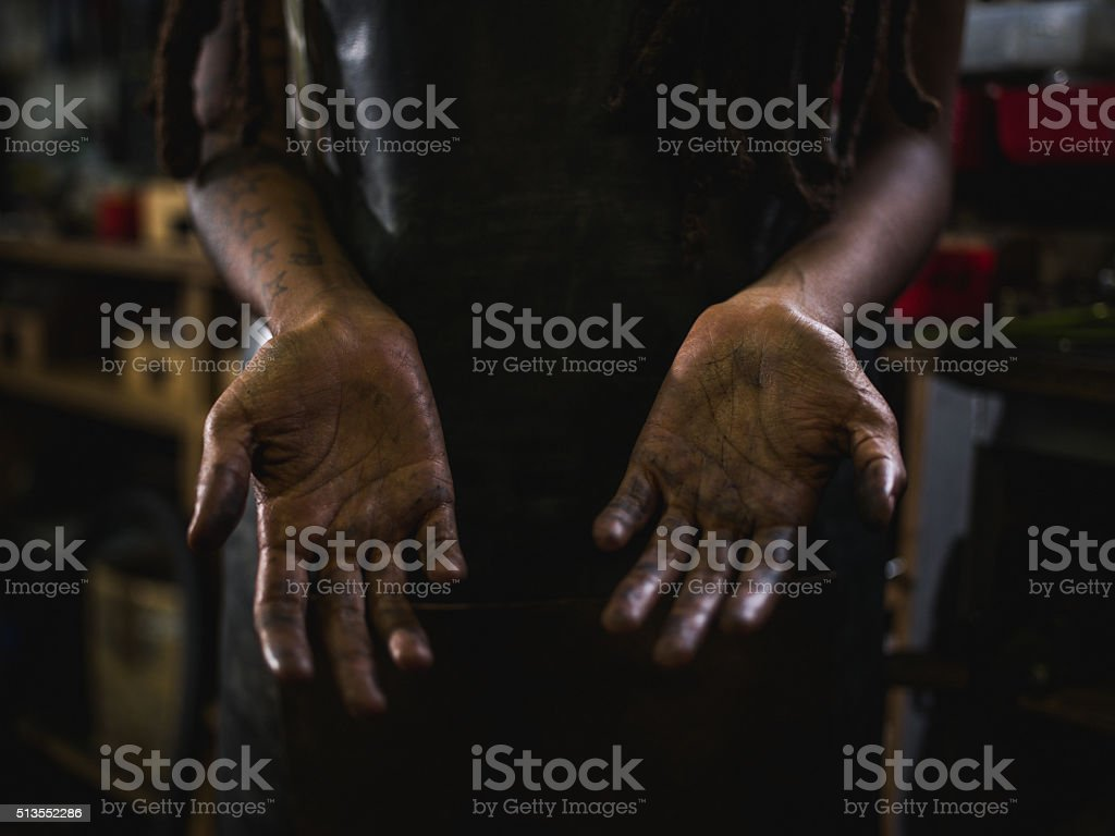 Craftswoman showing hands with grease and oil in the creases stock photo