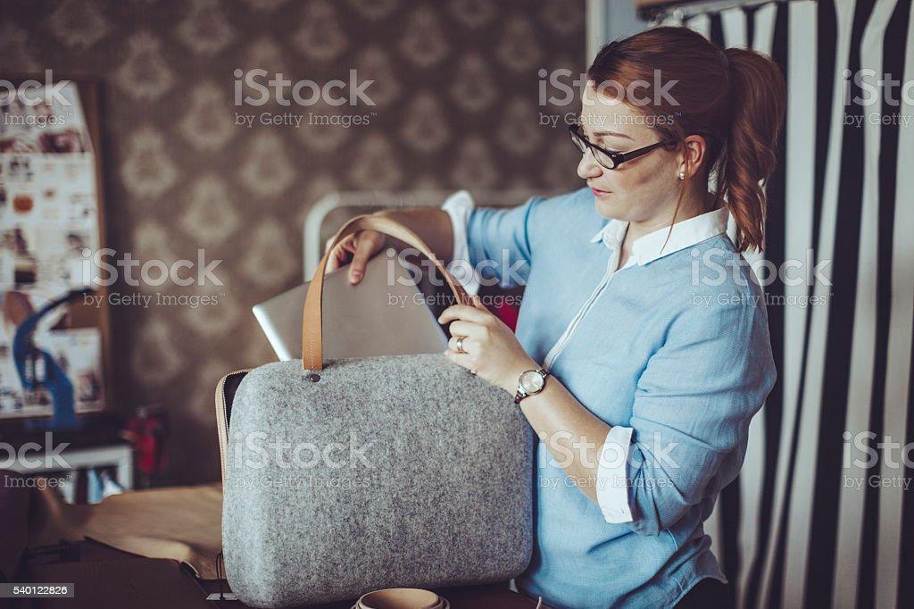 Craftswoman working in her workshop stock photo