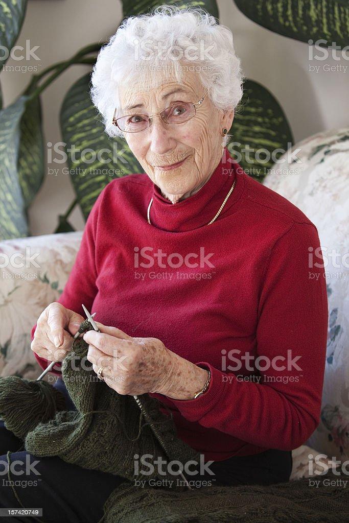 Crafty senior stock photo