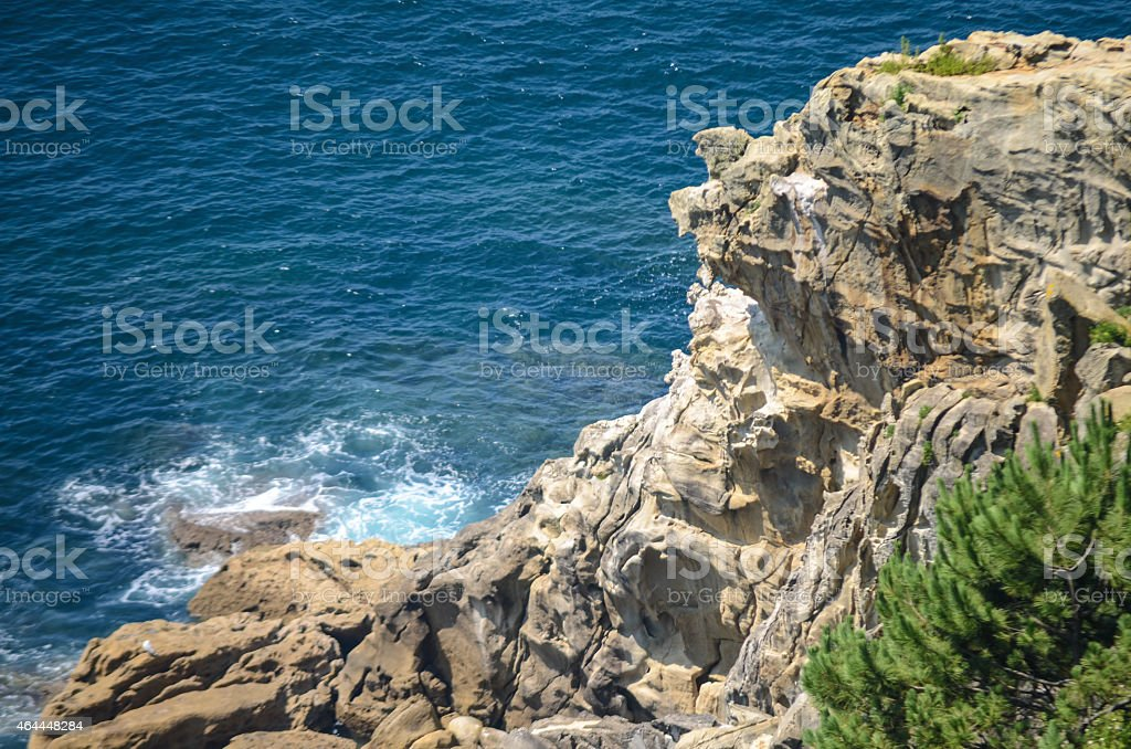 Crag and ocean stock photo