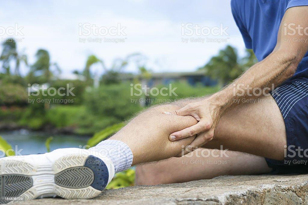 Cramp in calf stock photo