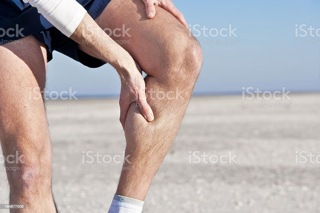 Cramp in calf stock photo