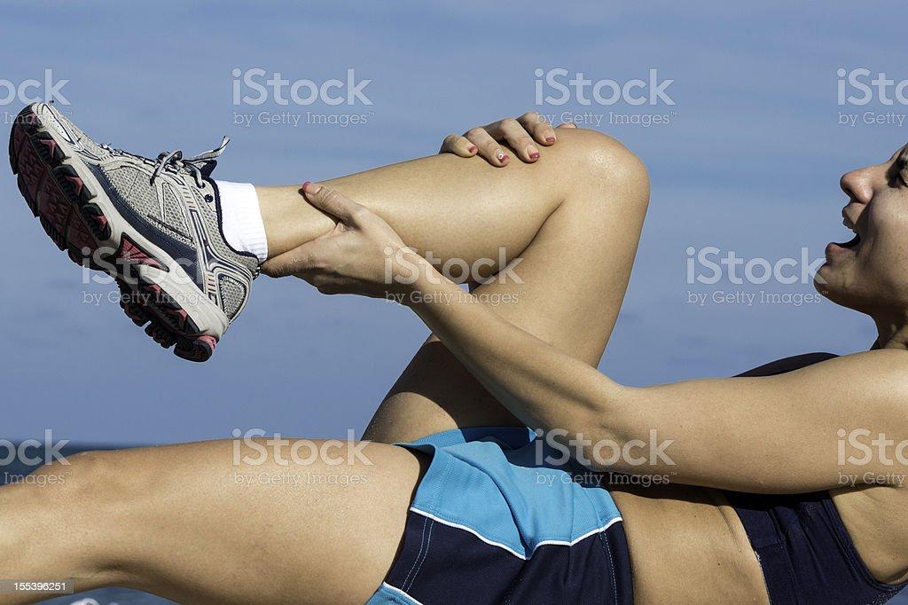 cramp in her calf stock photo