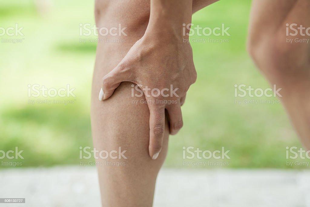 cramp in leg calf during sports activity stock photo