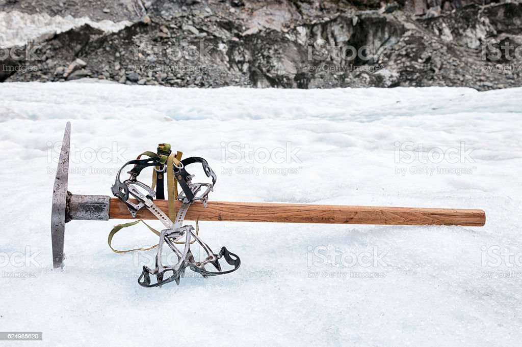 Crampons and Ice axe on Franz Josef Glacier, New Zealand stock photo