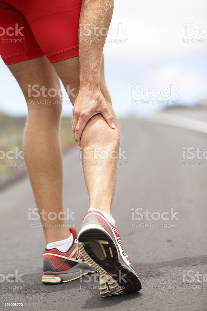 Cramps in leg calves stock photo
