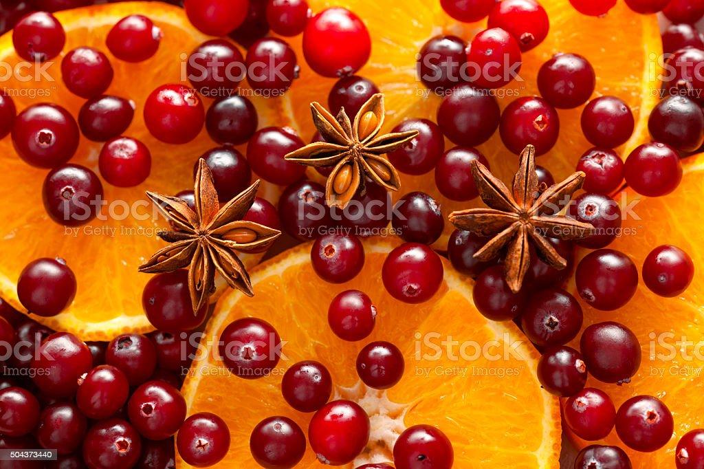 Cranberries, orange slices and star anise stock photo