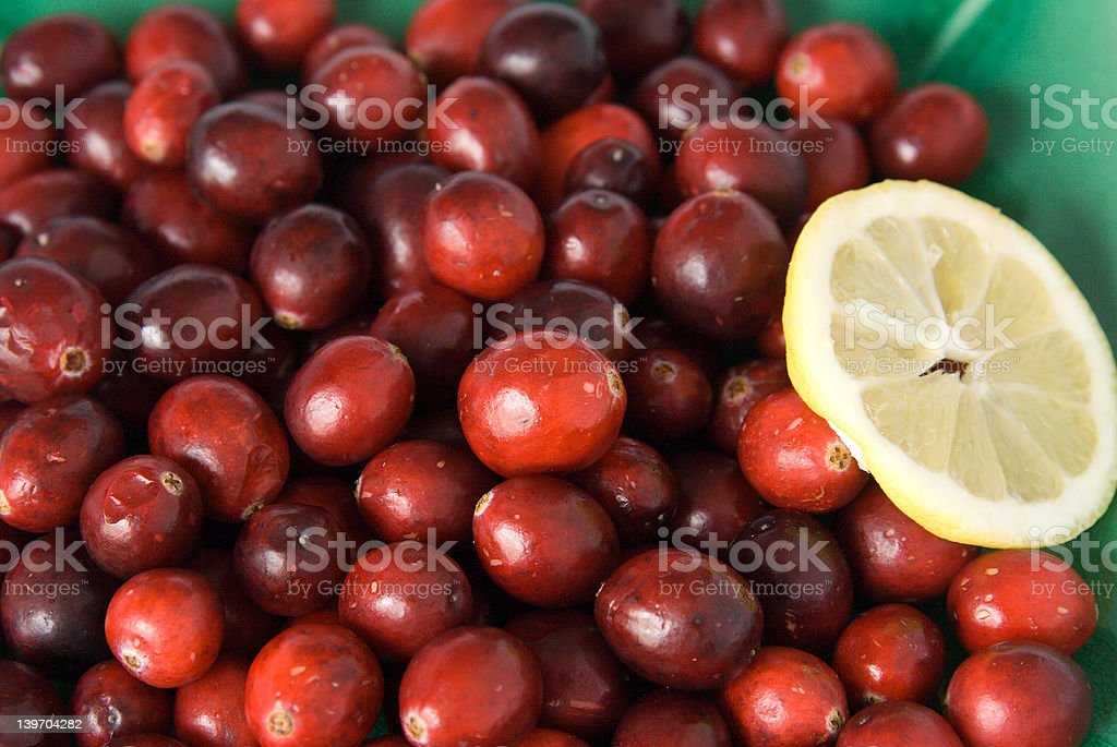 Cranberries with a slice of lemon royalty-free stock photo