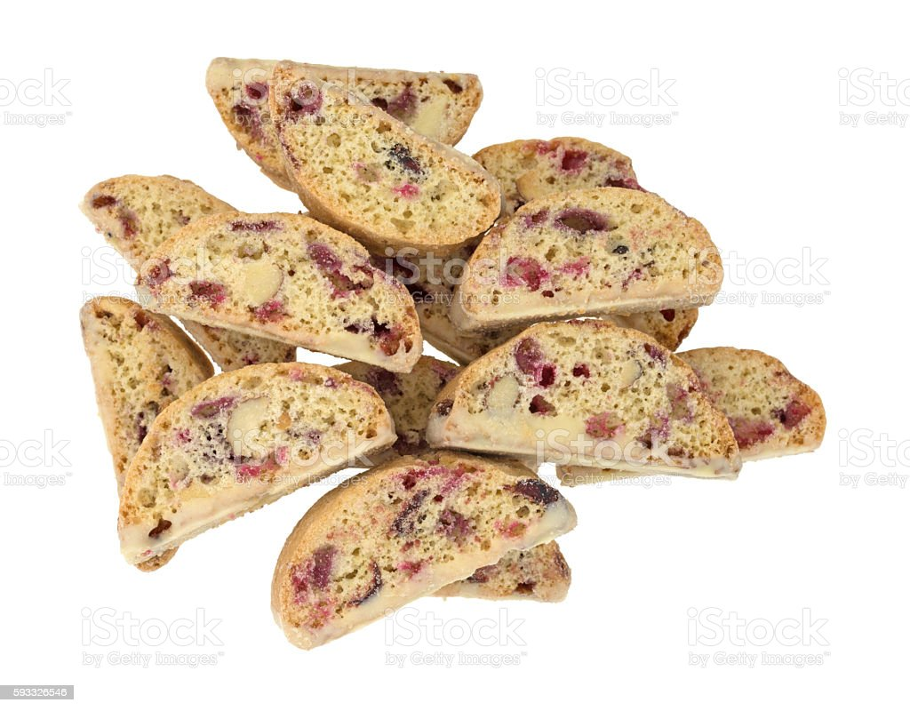 Cranberry almond biscotti with white chocolate on a white backgr stock photo