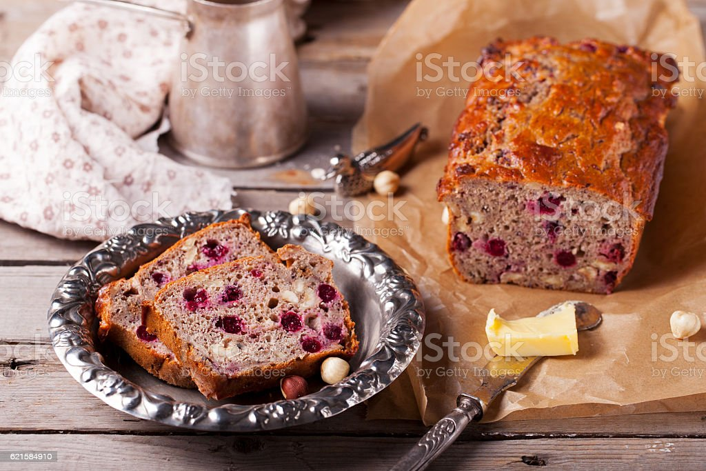 Cranberry and hazelnut wholegrain bead, loaf Rustic style. Wooden background stock photo