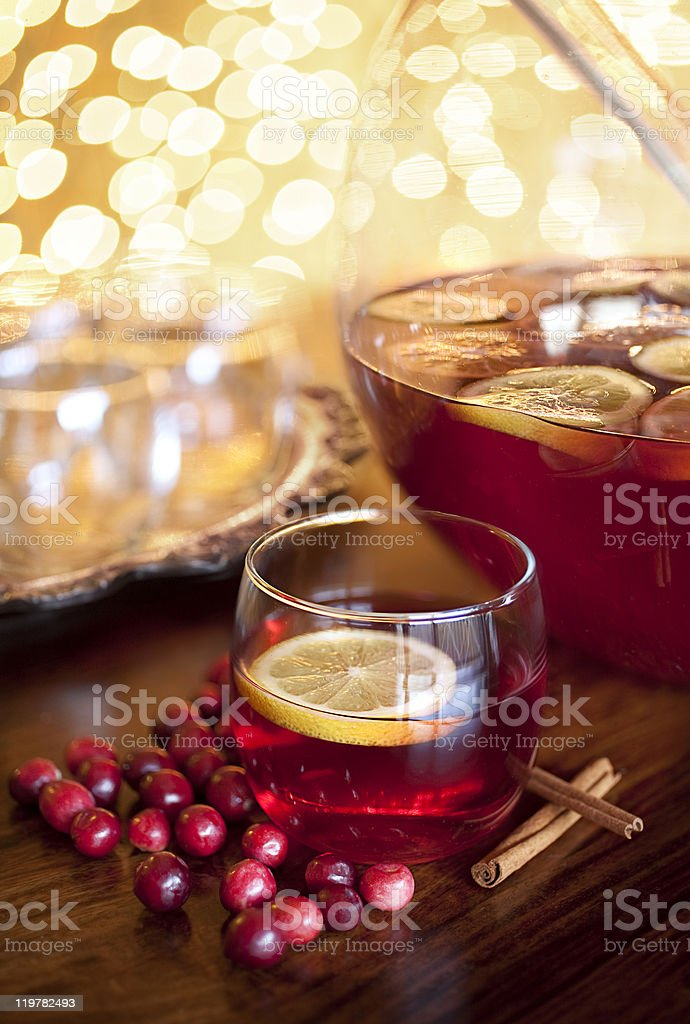 Cranberry and lemon punch in a bowl with a small glass stock photo