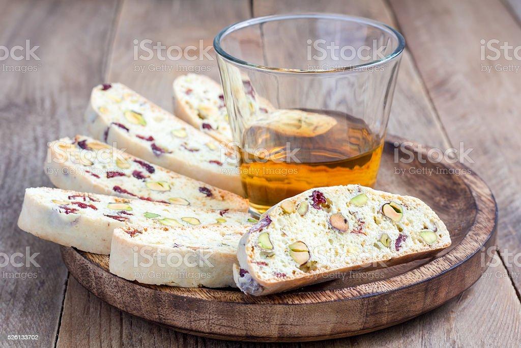 Cranberry and pistachio biscotti with vin santo  wine stock photo