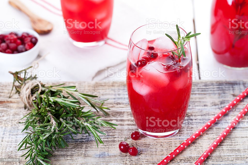 Cranberry and rosemary lemonade, cocktail, fizz on a wooden background stock photo