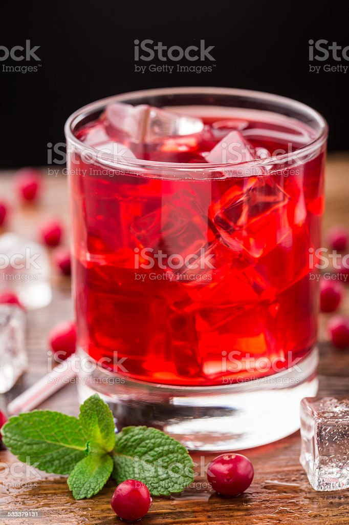 Cranberry cocktail with mint garnish. stock photo