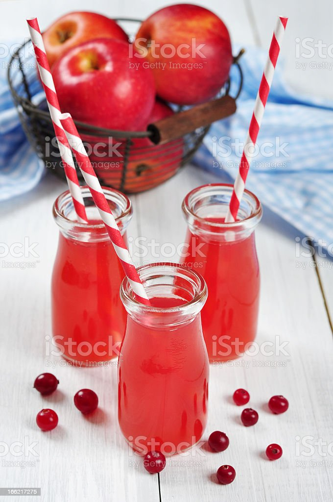 Cranberry juice in glass jars royalty-free stock photo