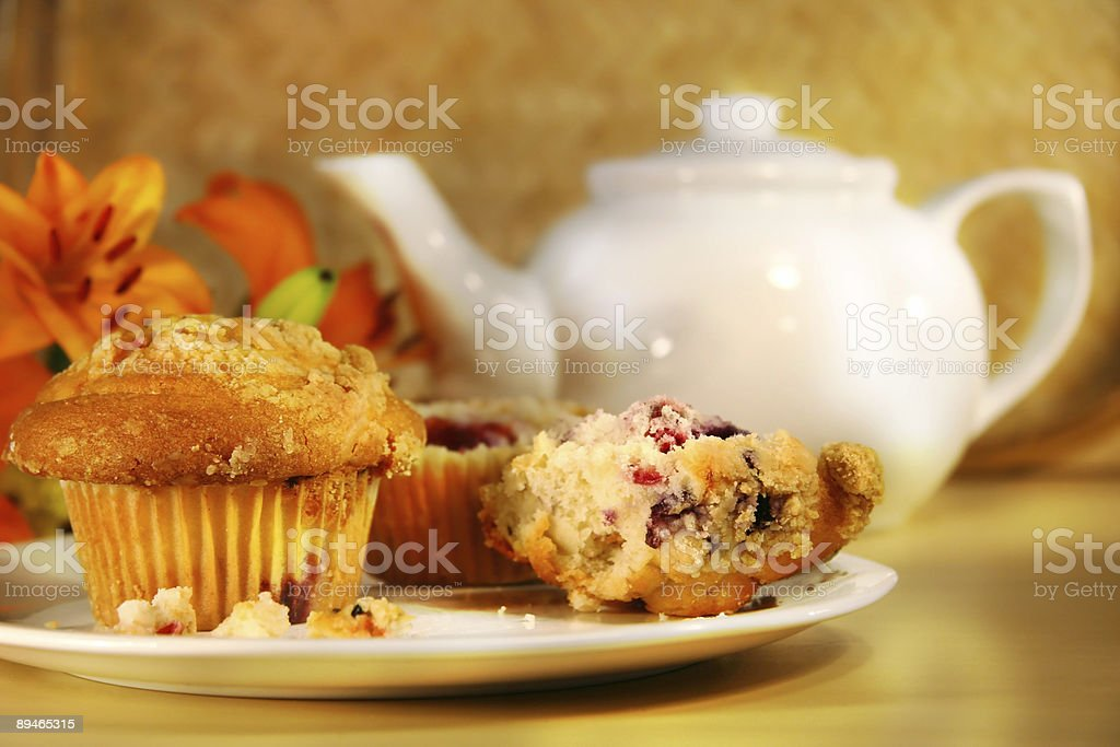 Cranberry muffins and tea stock photo