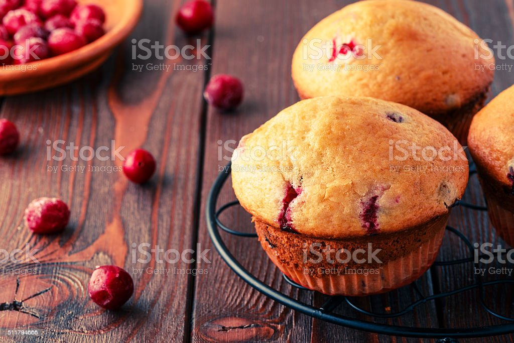 Cranberry muffins on wooden background. stock photo