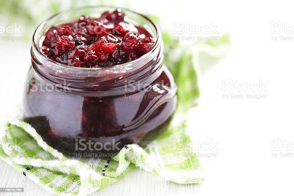 Cranberry sauce in glass jar stock photo