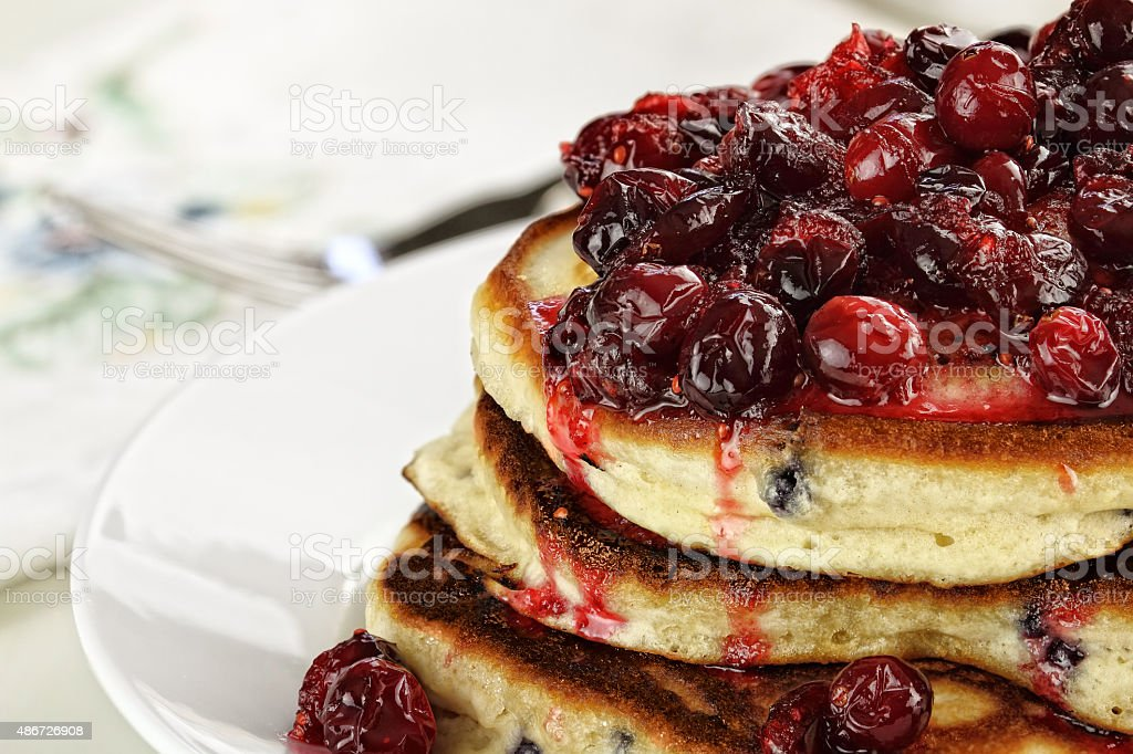 Cranberry Sauce over Fresh Pancakes stock photo