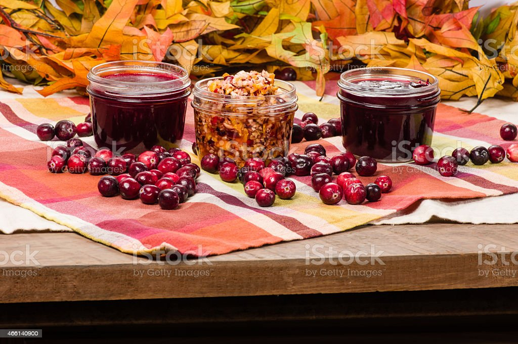 Cranberry sauce with cranberries on wooden table stock photo