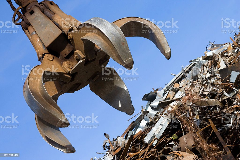 A crane about to grab sheet metal stock photo