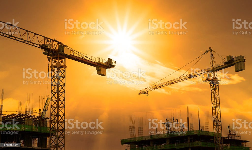 Crane and building construction in the morning stock photo