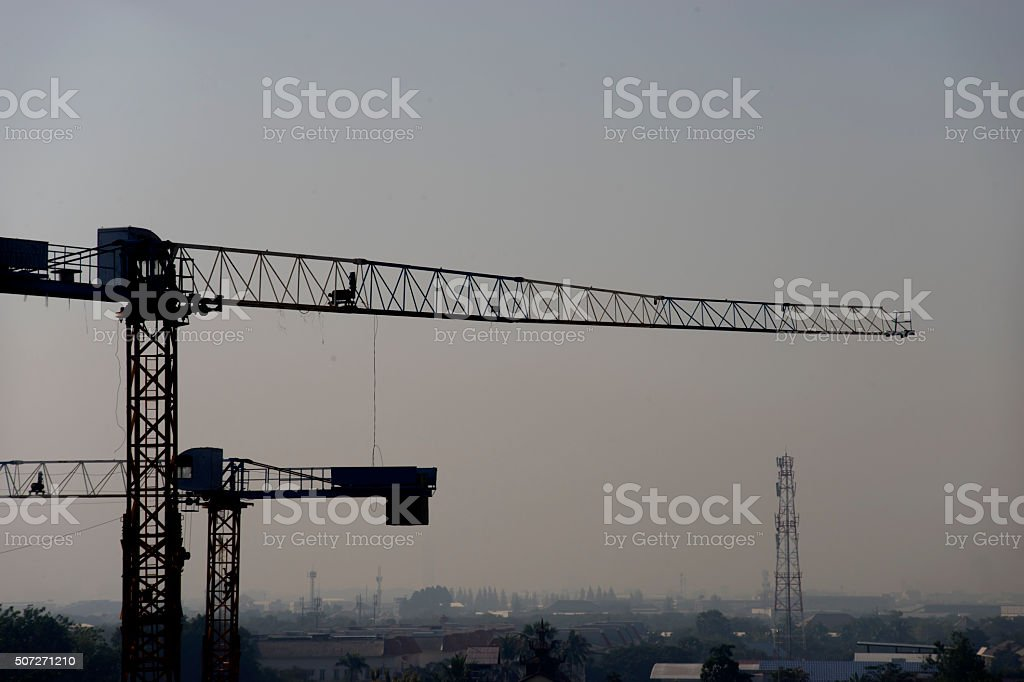 Crane and foggy sky 3 stock photo