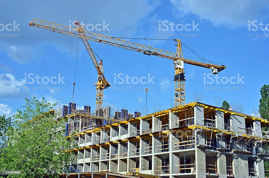 Crane and highrise construction site royalty-free stock photo