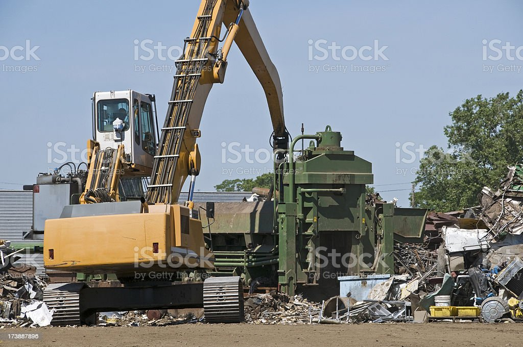Crane and metal compactor stock photo