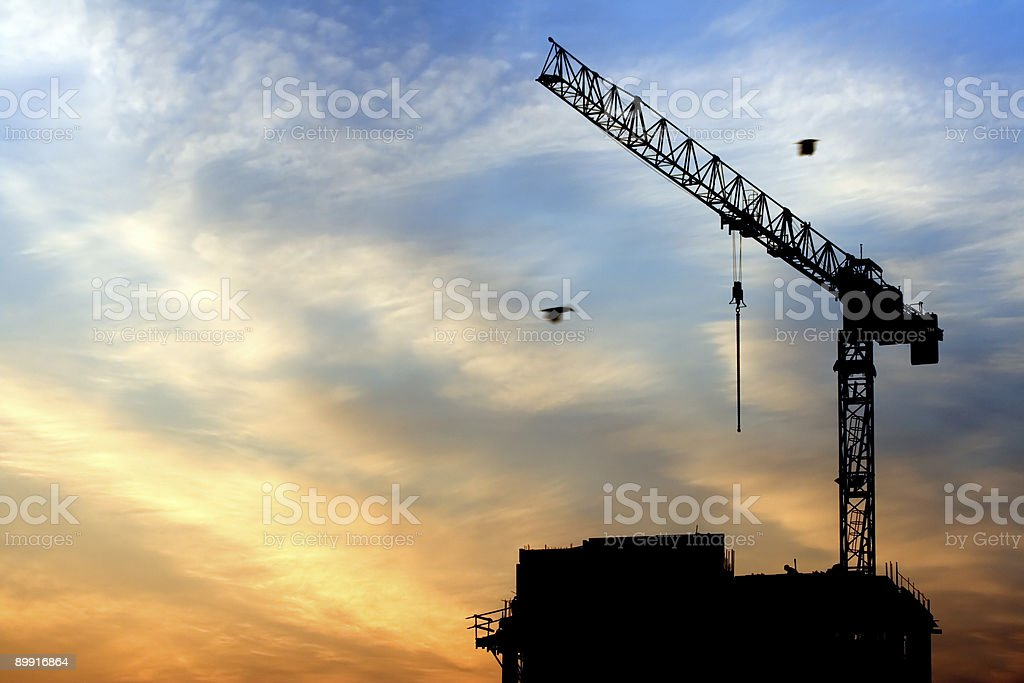 Crane and sunrise stock photo