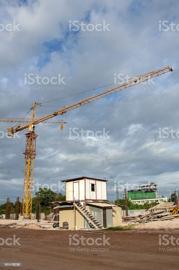 Crane and Temporary houses for worker near construction place. royalty-free stock photo