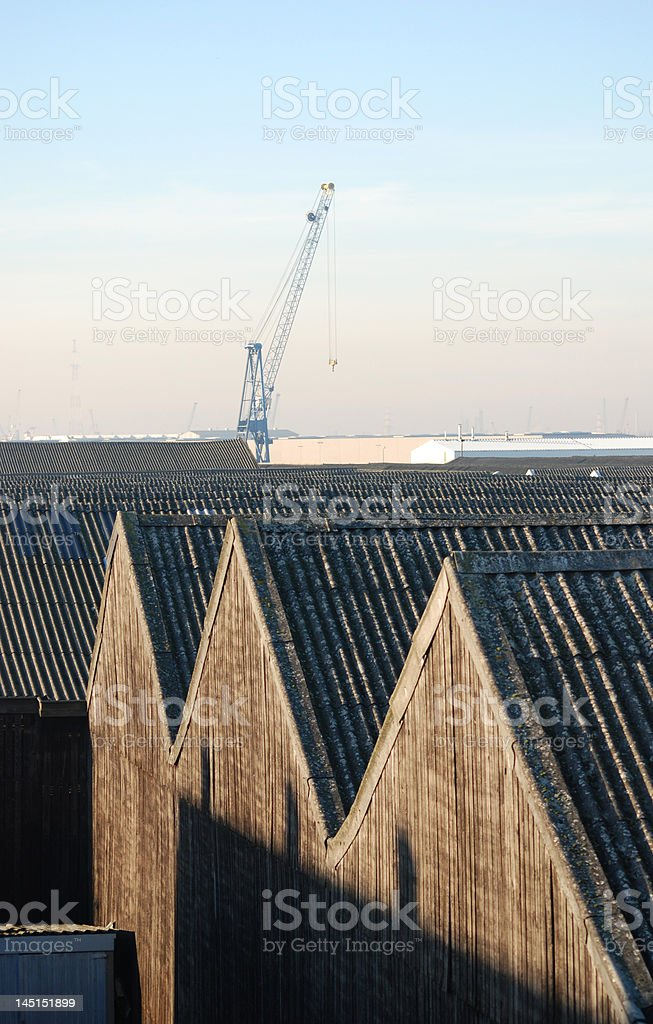 Crane and warehouses in the port of Antwerp royalty-free stock photo