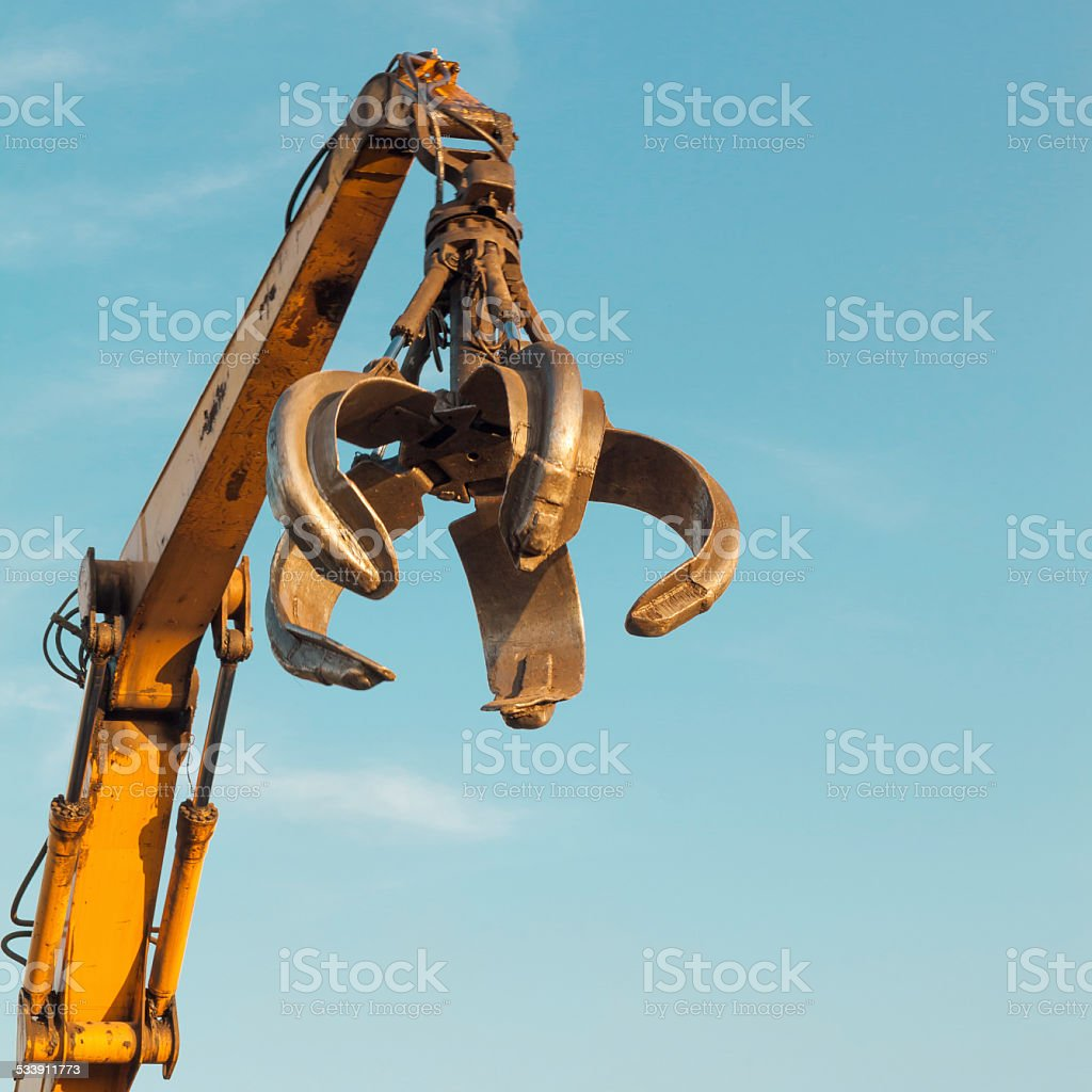 crane arm with open claw stock photo