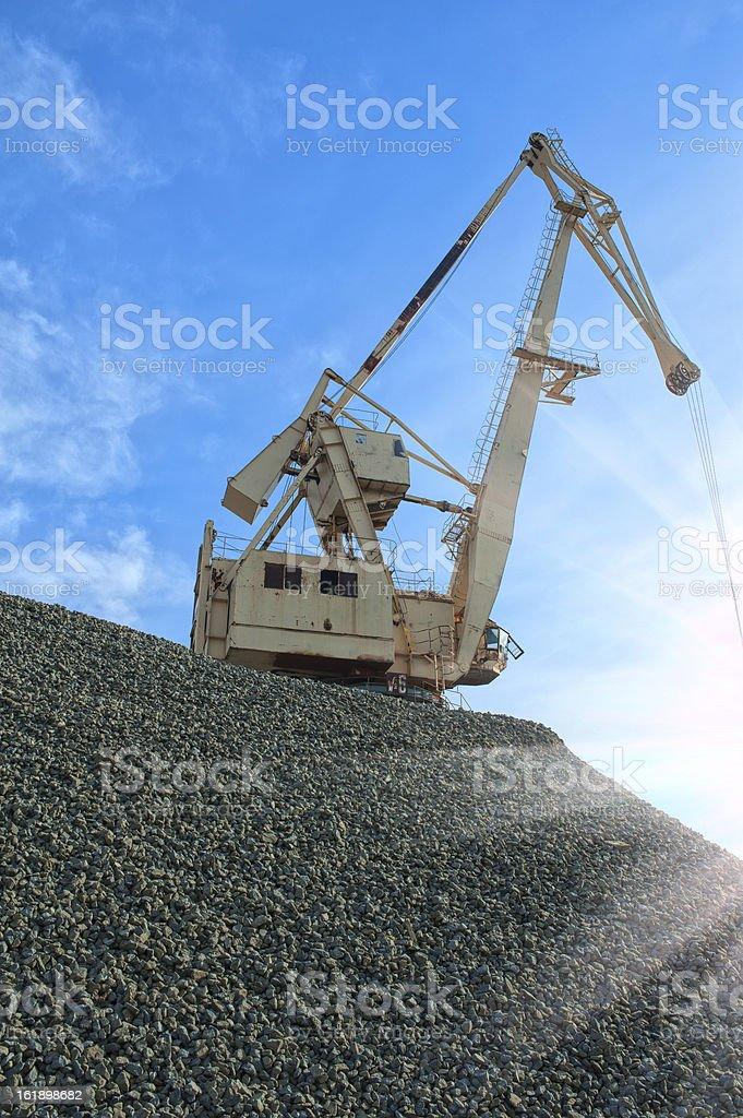 crane at heap of gravel royalty-free stock photo