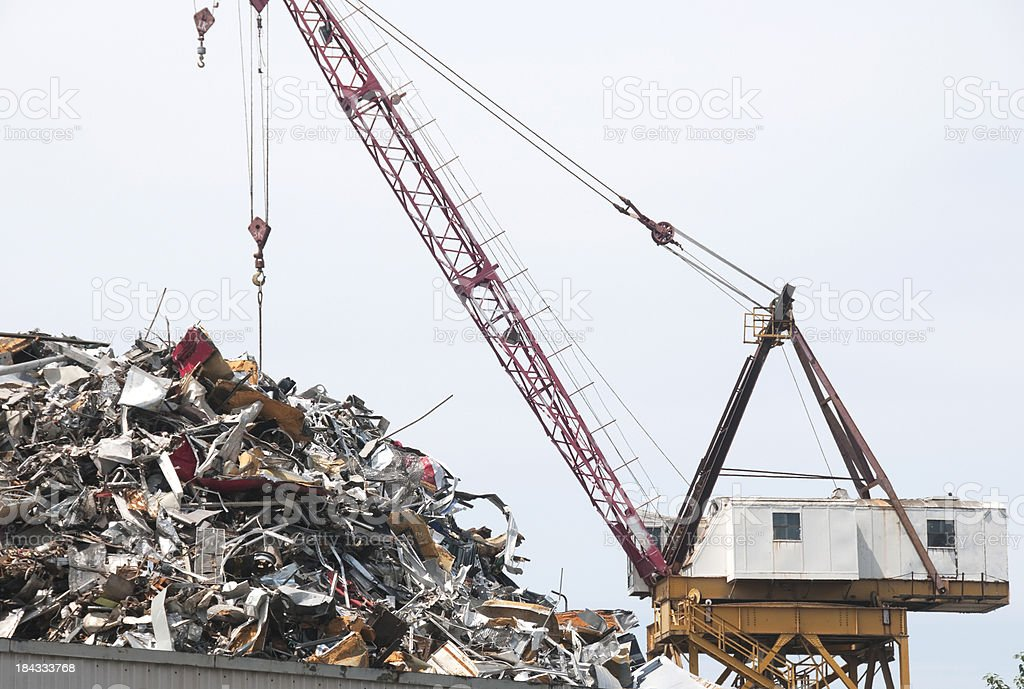 Crane at metal recycling plant royalty-free stock photo