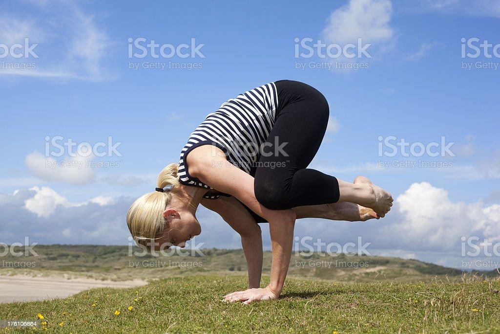 Crane Bakasana  yoga pose stock photo
