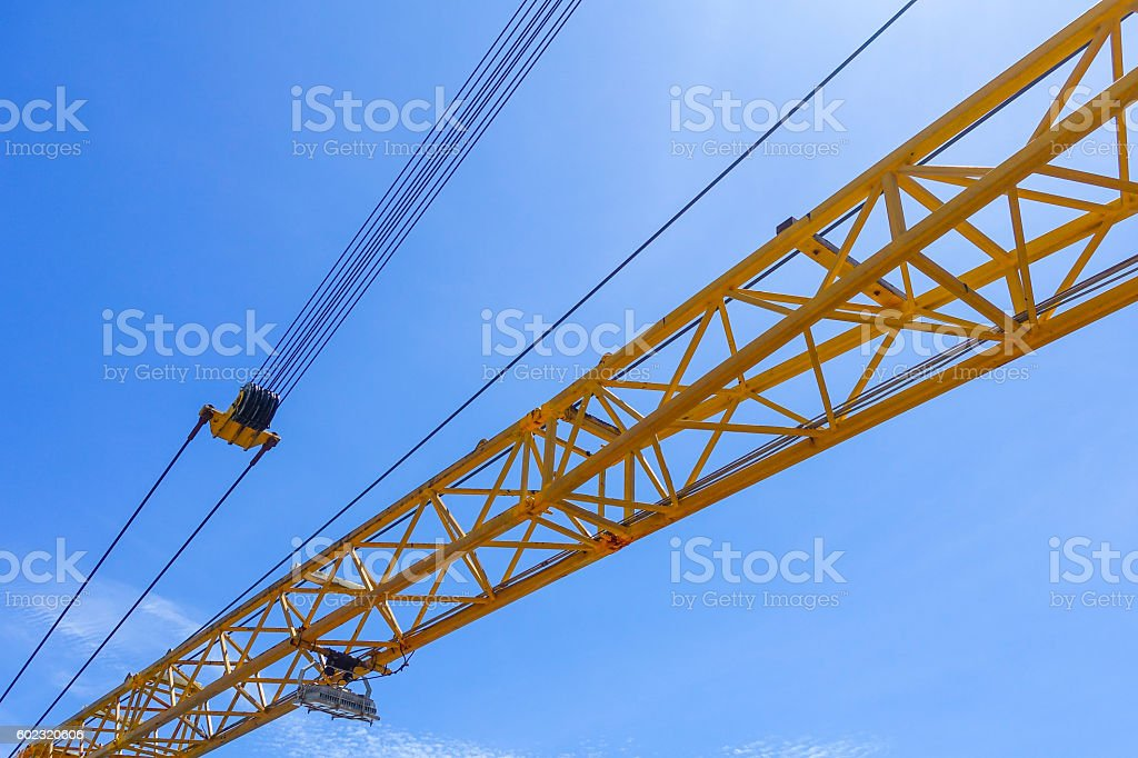 Crane boom structure and metal sling on blue sky stock photo