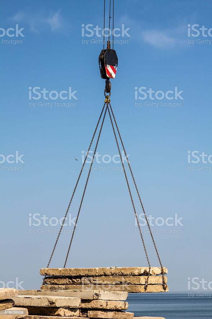 Crane carries concrete slabs stock photo