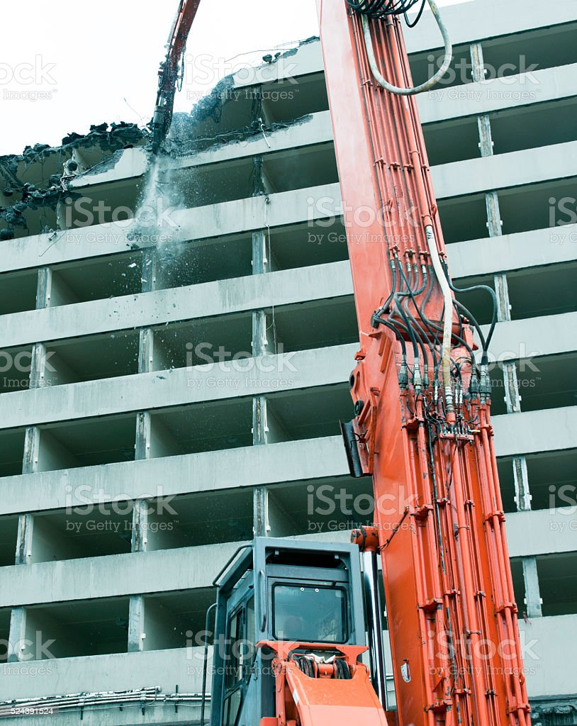 Crane demolishing building in Seattle WA stock photo