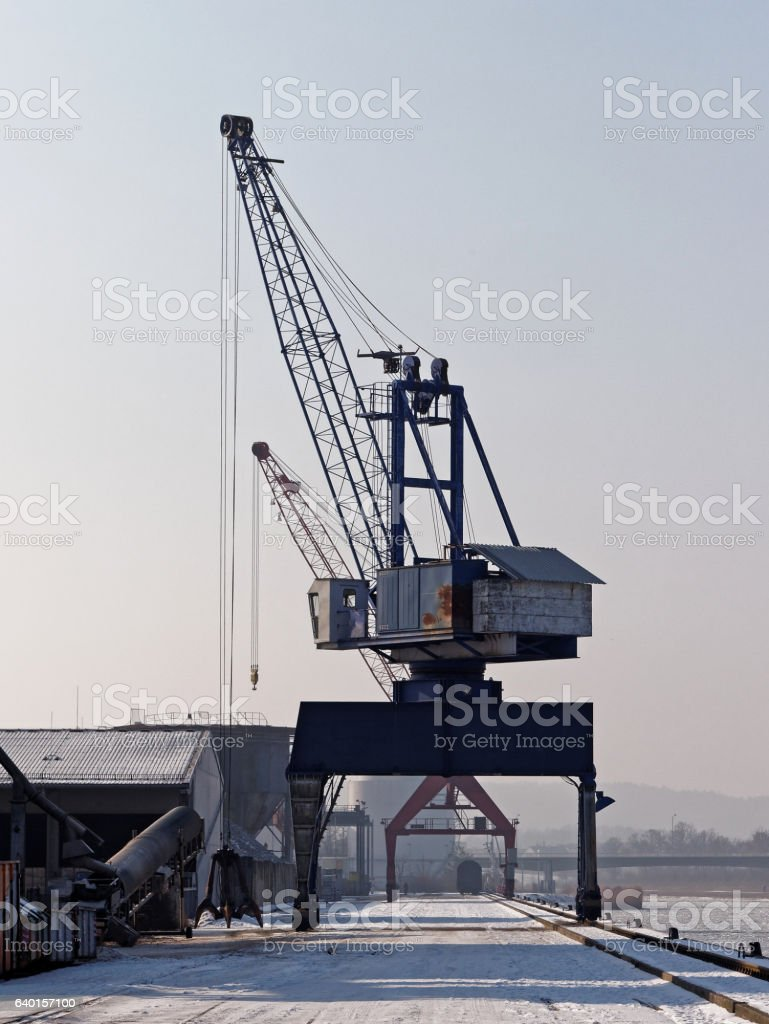 crane - freight harbor scene in winter stock photo