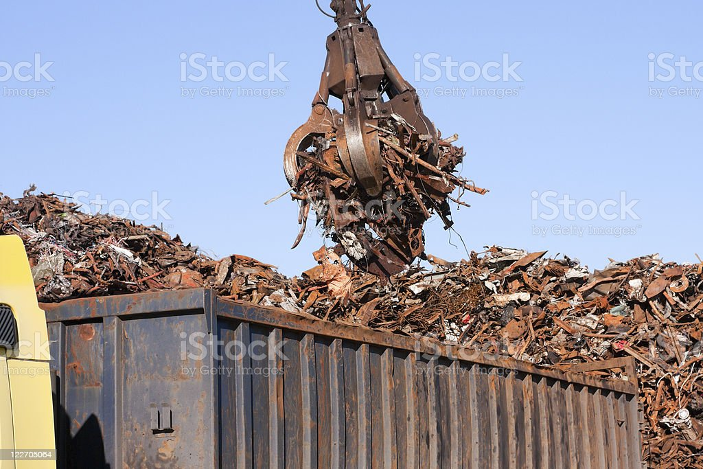Crane grabber loading a Truck with metal scrap royalty-free stock photo