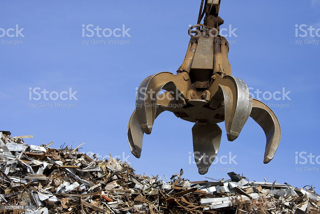 crane grabber up on the metal  heap stock photo