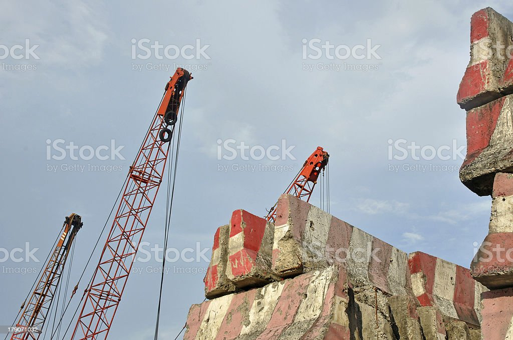 Crane hook and stack of concrete barriers royalty-free stock photo