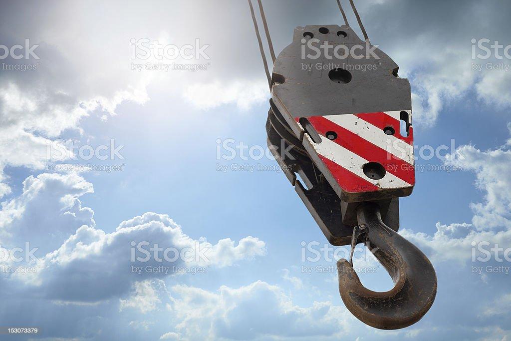 Crane hook on a blue sky royalty-free stock photo