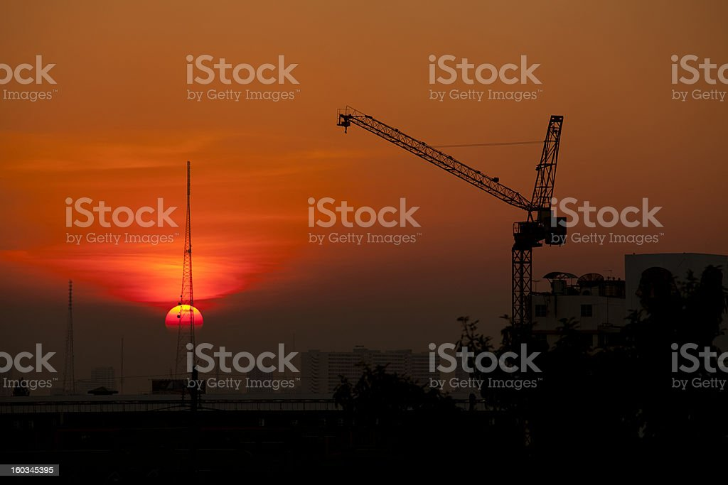 Crane in construction site at sunset royalty-free stock photo