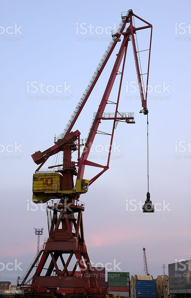 Crane in Harbor at Sunset stock photo