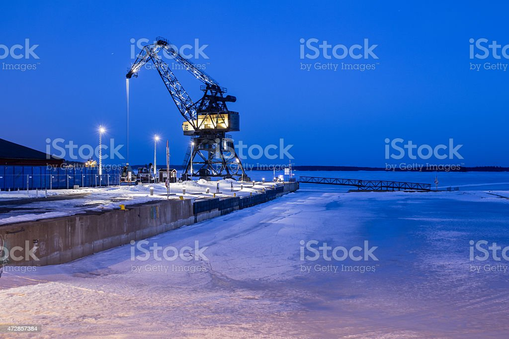 Crane in Lulea South harbour stock photo