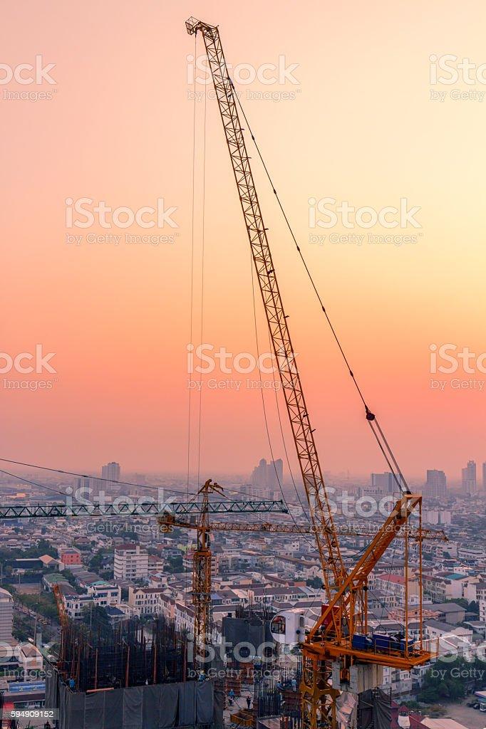 Crane in twilight stock photo