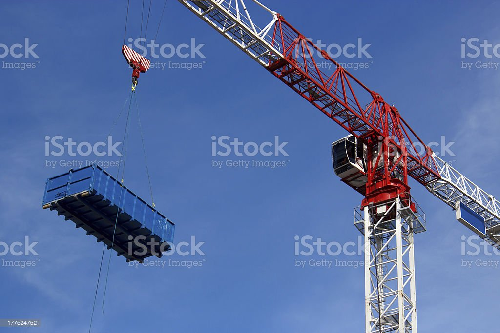 Crane is lifting dumpster royalty-free stock photo